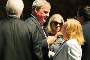 Former Governor John Rowland talks with family members outside the funeral service for former Lieutenant Governor Joseph Fauliso at St. Peter Claver Church in West Hartford in  2014.