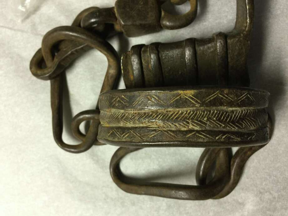 "Iron shackles are included in the Wilton Historical Society exhibit ""Tools of a Shameful Trade,"" which is on view through February. Photo: Wilton Historical Society / Contributed Photo / Connecticut Post Contributed"