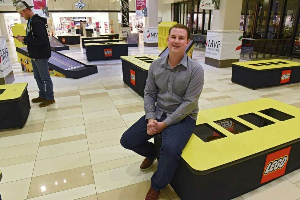 Andrew Little of Creatacor sits in the area that will offer lego building opportunities for shoppers at the LEGO Americana Roadshow at Crossgates Mall on Friday, Feb. 8, 2019 in Guilderland, N.Y. The larger than life LEGO replicas of some of America?•s most well-known and beloved architectural structures will be on display February 9-24. (Lori Van Buren/Times Union)