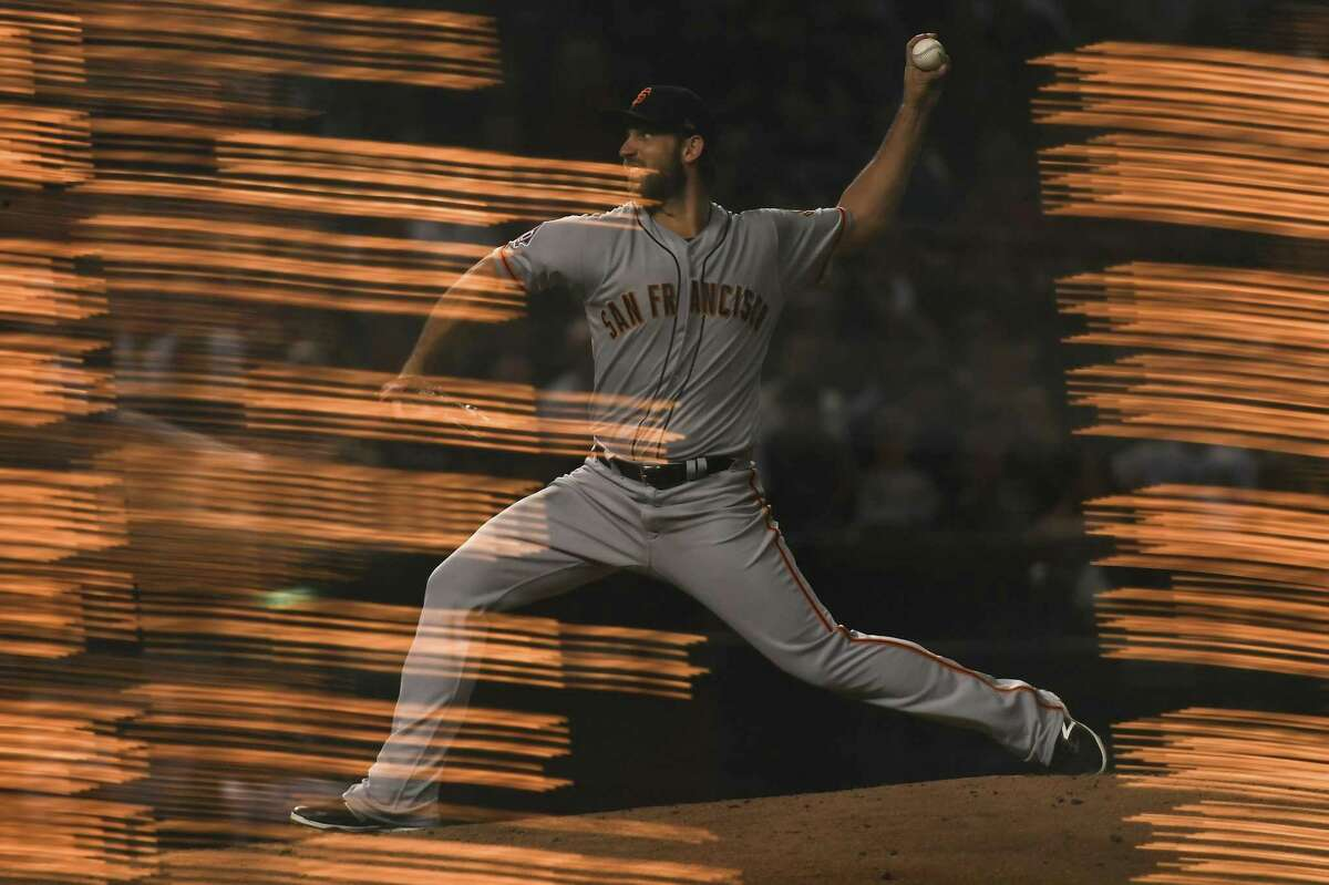 PHOENIX, AZ - AUGUST 02: (EDITORS NOTE: Image was created using multiple exposures in camera.) Madison Bumgarner #40 of the San Francisco Giants delivers a pitch during the MLB game against the Arizona Diamondbacks at Chase Field on August 2, 2018 in Phoenix, Arizona. (Photo by Jennifer Stewart/Getty Images)