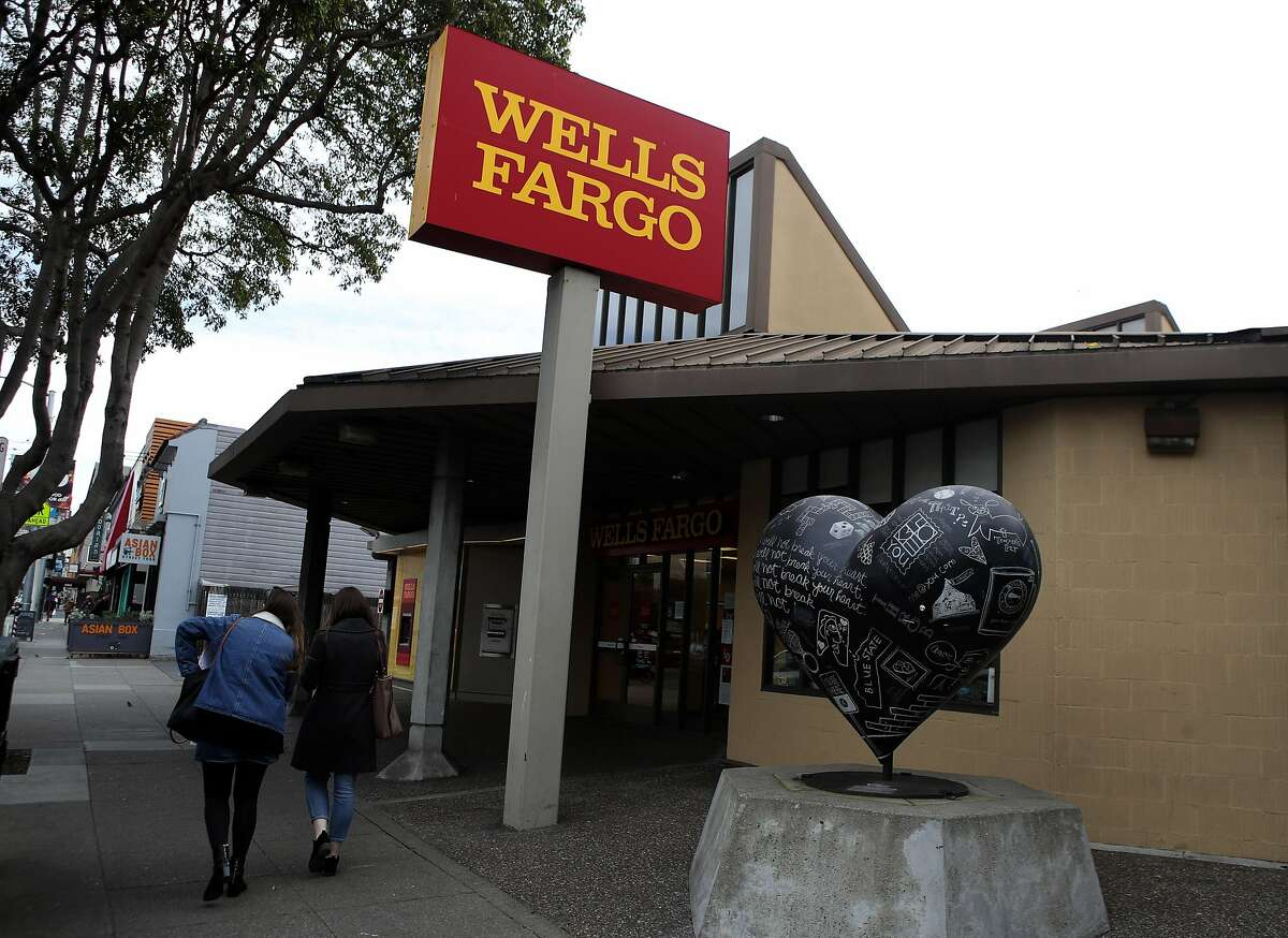 SAN FRANCISCO, CALIFORNIA - FEBRUARY 07: Pedestrians walk by a Wells Fargo Bank office on February 07, 2019 in San Francisco, California. Wells Fargo customers are experiencing difficulty using ATMs and the Wells Fargo phone app after reports of a technical issue at the outage at a server farm located in Shoreview, Minnesota. (Photo by Justin Sullivan/Getty Images)