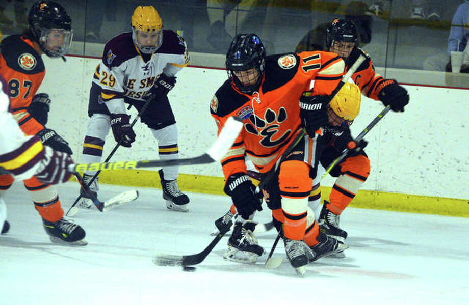Edwardsville's Sam Gibbons controls the puck during the first period of Thursday's Mid-States game against De Smet at the Queeny Recreational Complex. Photo: Scott Marion | For The Telegraph