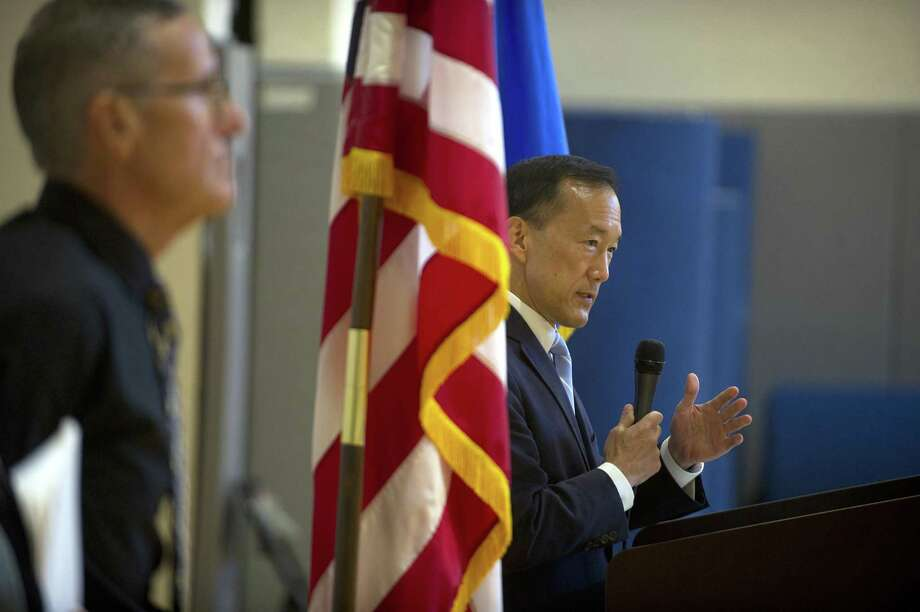 Superintendent Earl Kim speaks during the combined Stamford High School and Westhill High School summer school graduation held inside Stamford High School in Stamford, Conn. on Thursday, Aug. 2, 2018. Kim has announced he is stepping down as superintendent. Photo: Michael Cummo / Hearst Connecticut Media / Stamford Advocate