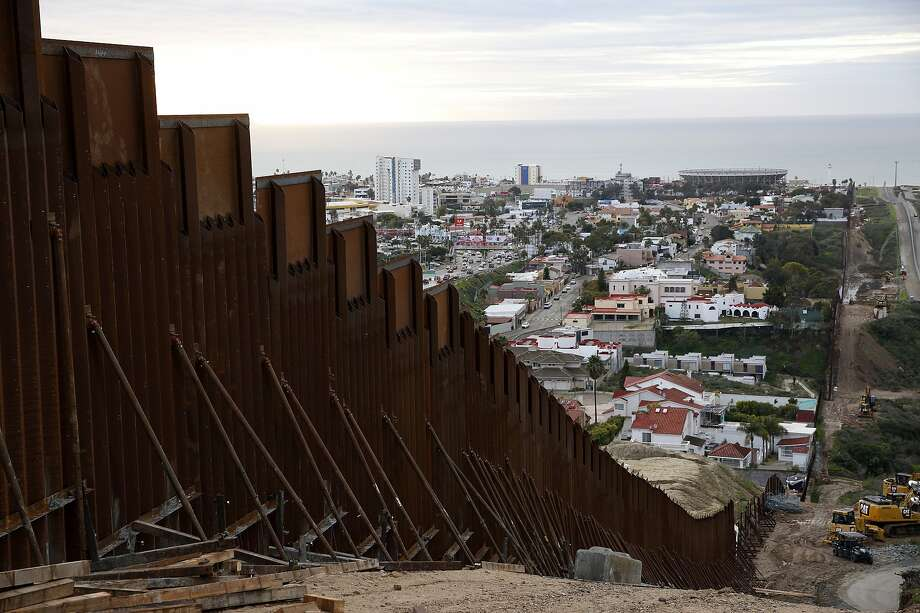 A section of border wall separates Tijuana, Mexico (left), from San Diego. House and Senate negotiators were nearing a deal on border security funding. Photo: Gregory Bull / Associated Press