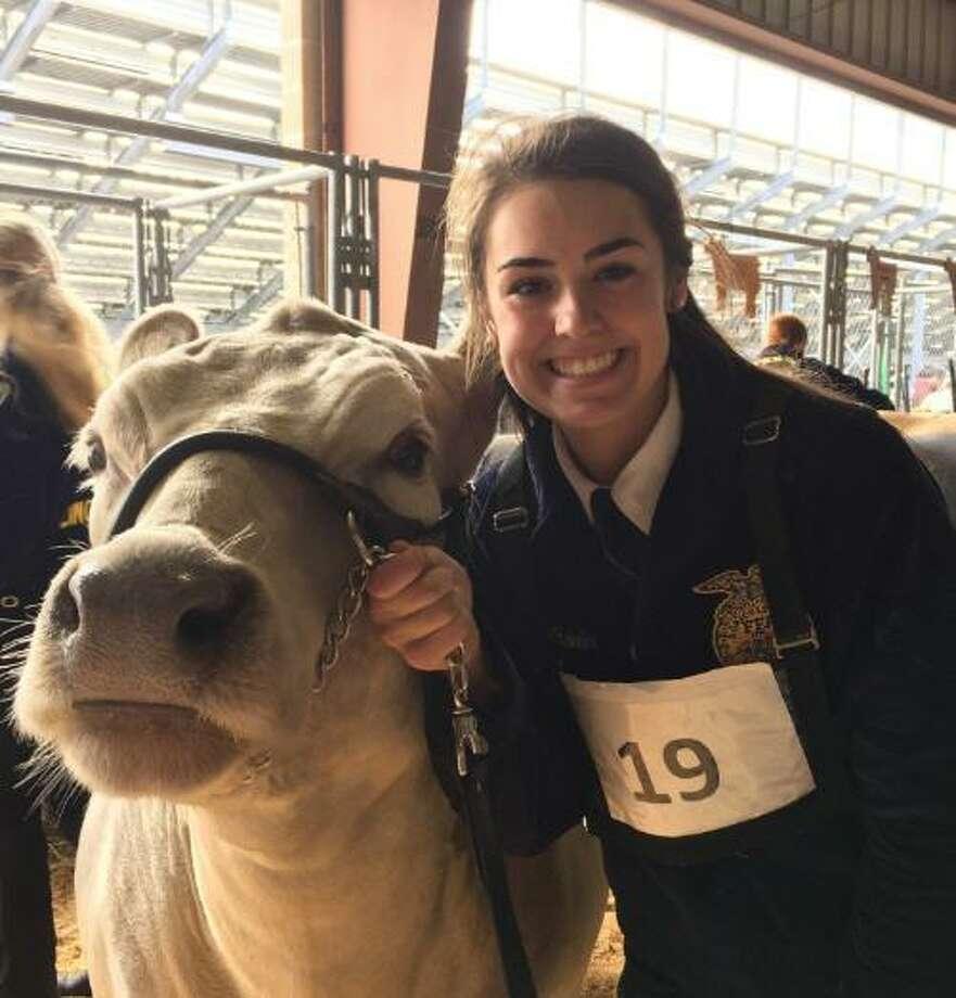 Cinco Ranch High School junior Rachel Wheeler raised the grand champion steer for last year's Katy Independent School District FFA Livestock Show & Auction. Jax sold for $20,000. Photo: Karen Zurawski / Karen Zurawski