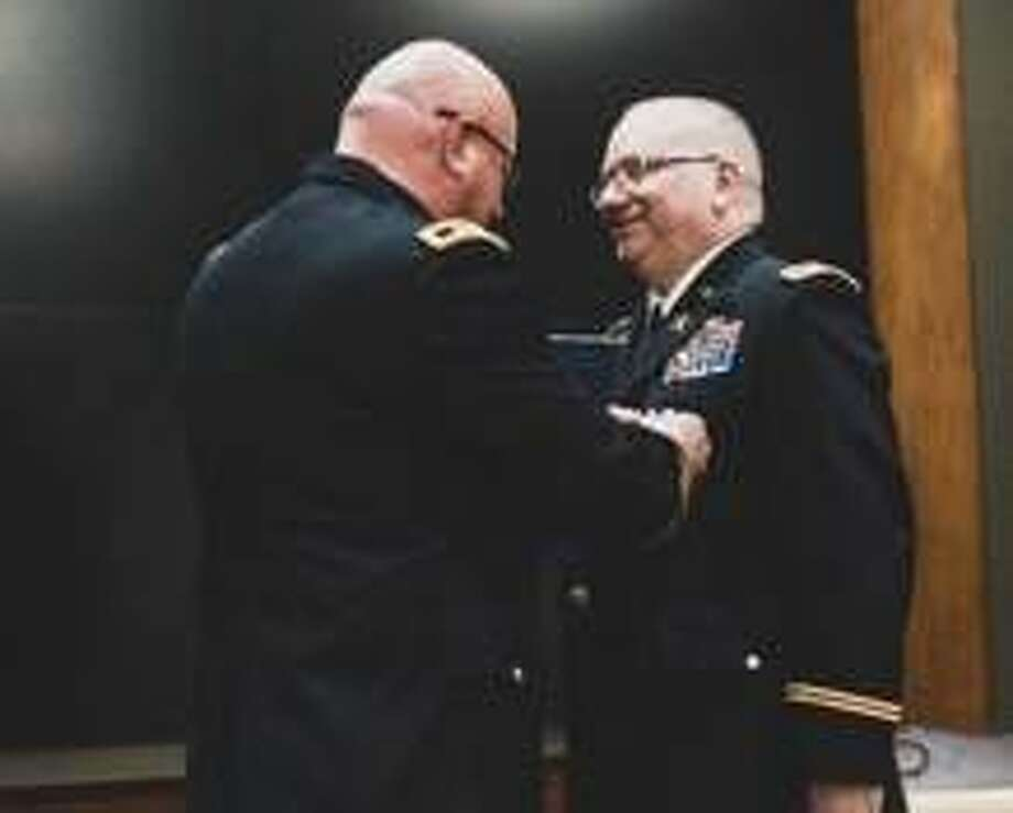Maj. Gen. Michael R. Zerbonia, Assistant Adjutant General-Army, presents Col. Joseph Schweickert, Illinois National Guard Chief of Staff, with the Legion of Merit and the Illinois National Guard Distinguished Service Medal during Schweickert's retirement ceremony, Jan. 18. Photo: Courtesy Photo