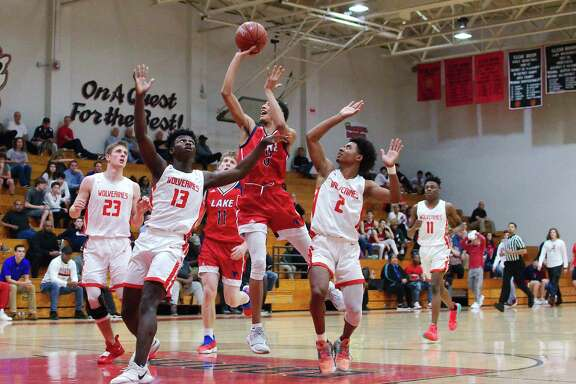 Clear Lake's Jaja Sanni (3) puts up a shot while being defended by Clear Brook's Shane Porter (23), Jordan Baker (13) and Paul Wilson (2).