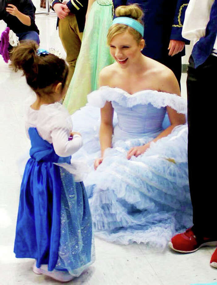 Cinderella visits with a youngster at last year's HOSA Princess Tea Party at EHS. Photo: For The Intelligencer