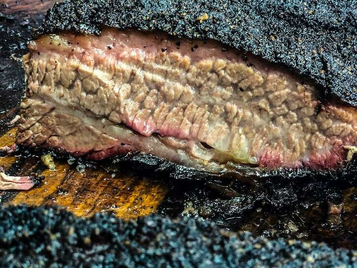 It takes a lot of wood shoveling to get the right result at Brett's Barbecue Shop in Katy.