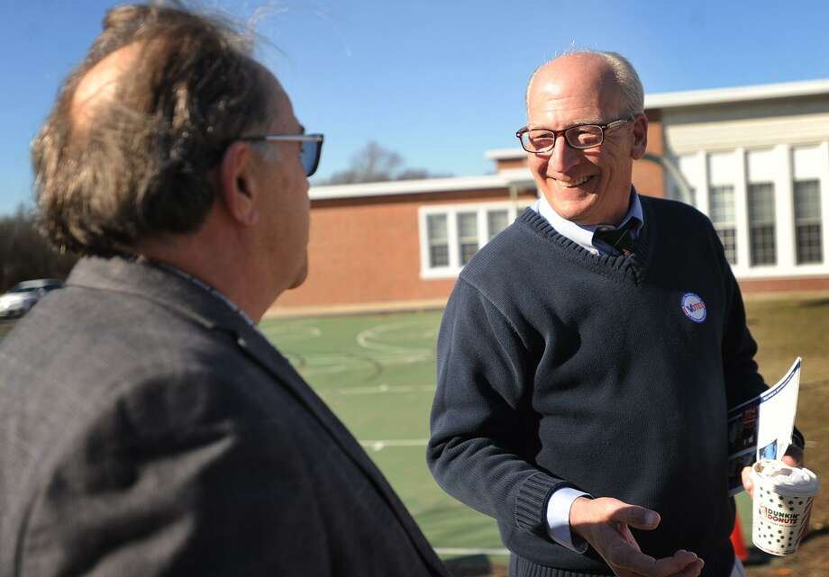 Voter Harold Watson, left, chats with Democratic candidate for state representative for the 120th District Phil Young outside the polls at Wooster Middle School in Stratford, Conn. on Tuesday, February 27, 2018. Photo: Brian A. Pounds / Hearst Connecticut Media / Connecticut Post