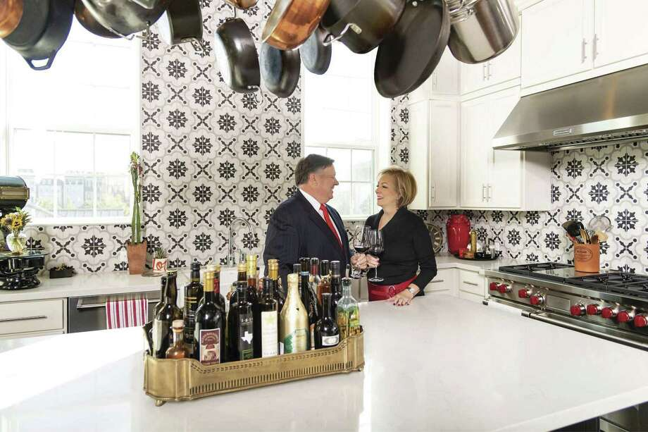 Restauranteur Bill Floyd and his wife, Charlene, are proud owners of a four-story chateau built by Toll Brothers and customized to include custom tilework, a wine room, and a fourth-floor fireplace by which to enjoy their view of the downtown skyline.
