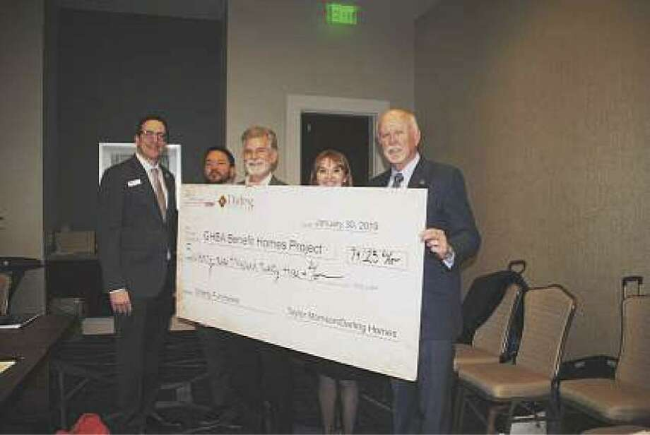 From left are John Williams, president of GHBA; Carl Salazar, executive director of HomeAid Houston; Bill Dalton, vice president of land for Taylor Morrison/Darling Homes; Casey Morgan, CEO of GHBA and Dan Wallrath, founder of Operation Finally Home displaying the Benefit Homes check from Taylor Morrison/Darling Homes at the February GHBA board meeting.