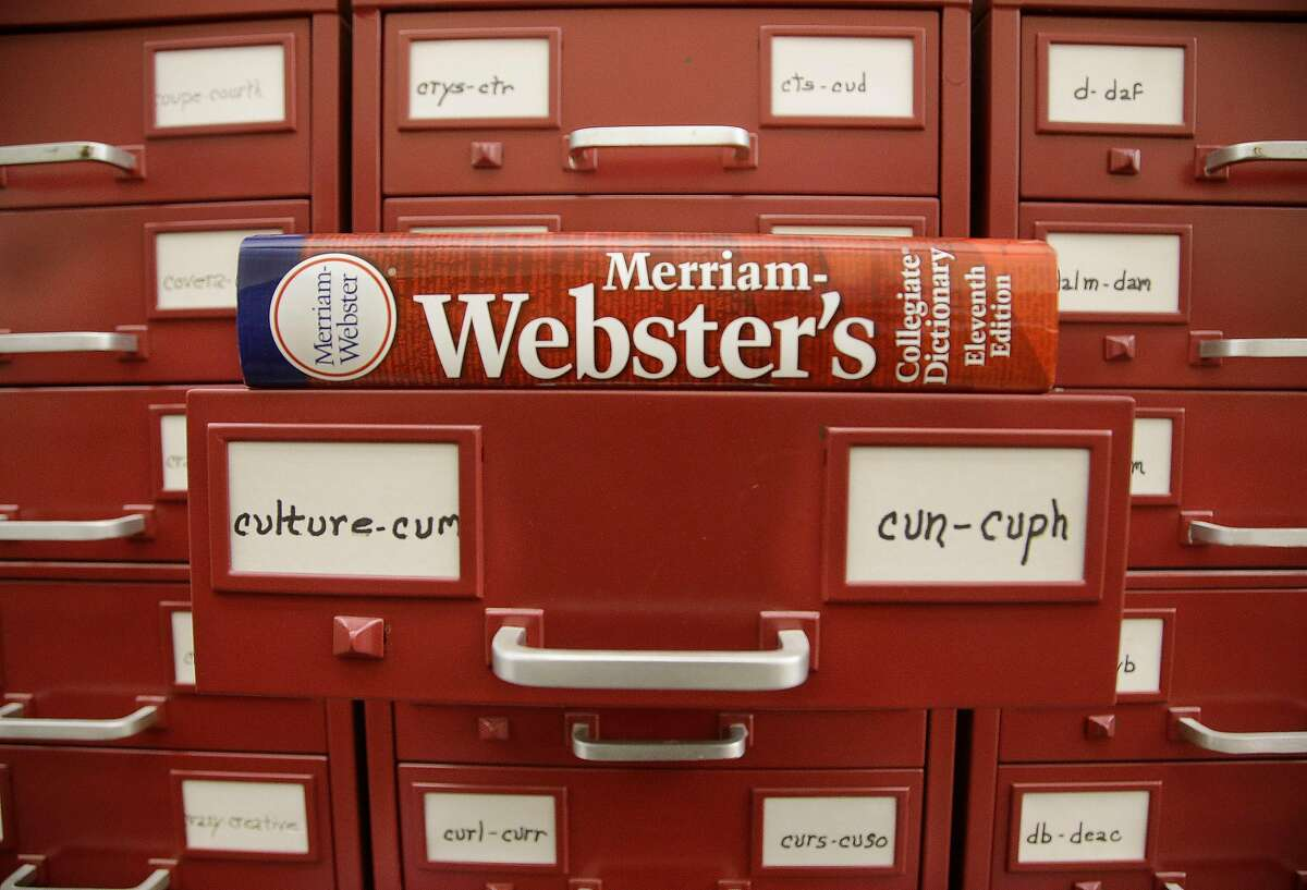 In this Tuesday, Dec. 9, 2014 photo, a Merriam-Webster dictionary sits atop their citation files for the 2014 word of the year,