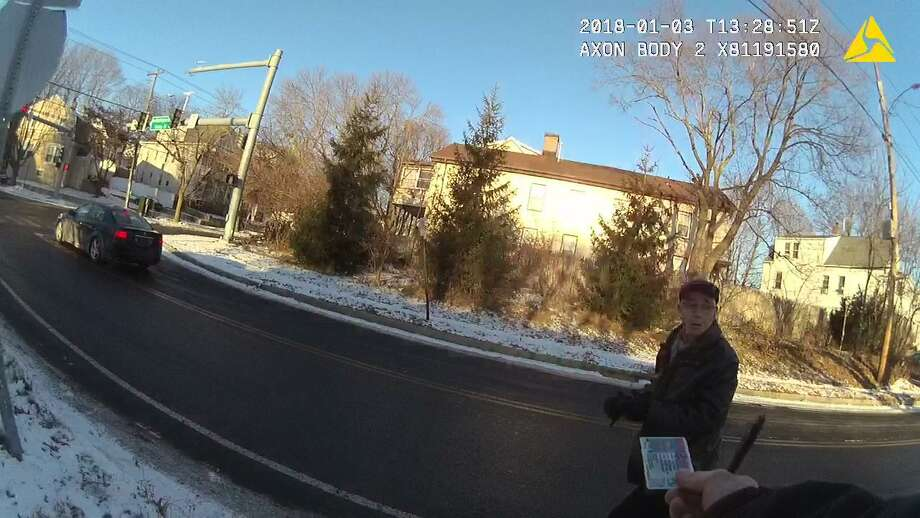 East Haven Mayor Joseph Maturo Jr. strolls back to get his belongings from his town-owned car — and is given back his driver's license — after talking to a police officer. Still photo from New Haven Police Department body-cam footage of the aftermath of East Haven Mayor Joseph Maturo Jr.'s Jan. 3, 2018 two-vehicle auto accident in The Annex section of New Haven. Photo: Contributed / New Haven Police Department /