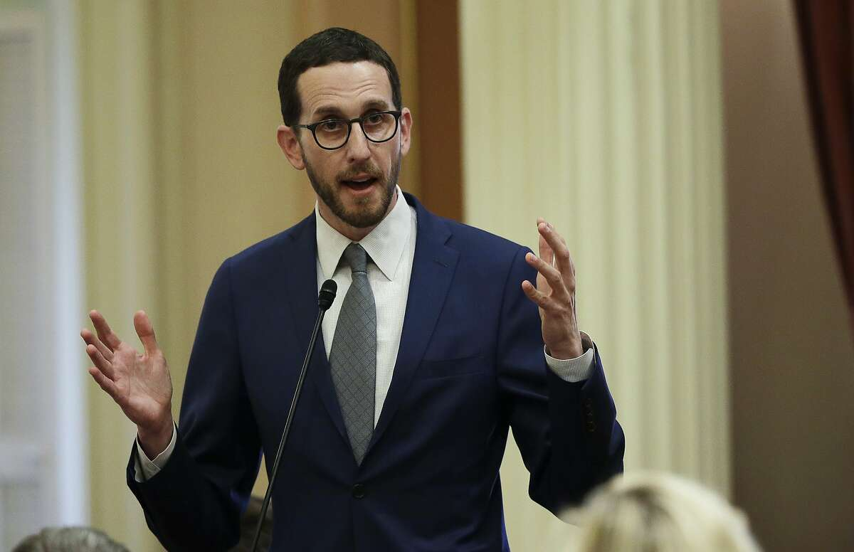 FILE - In this June 28, 2018, file photo, State Sen. Scott Wiener, D-San Francisco, speaks to members of the Senate in Sacramento, Calif. A new California bill would ban doctors from performing treatment or surgery on the genitalia of intersex children unless its medically necessary or the child is old enough to consent. The California Medical Association said it has serious concerns with the legislation because it removes doctors ability to respond to cases on an individual basis. Wiener's bill released Monday, Feb. 4, 2019, is the latest effort in California aimed at giving minors more control over their bodies and gender identities. (AP Photo/Rich Pedroncelli, File)