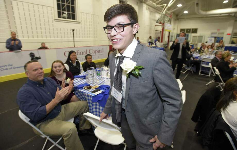 Michael Rincon, a senior at Greenwich High School, reacts with a smile after he is introduced as Youth of the Year during the Boys and Girls Club of Greenwich YOY dinner on Thursday, Feb. 7, 2019 in Greenwich, Connecticut. Photo: Matthew Brown / Hearst Connecticut Media / Stamford Advocate