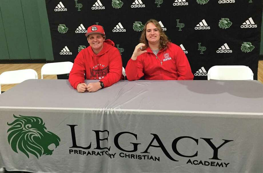 Legacy Prep football players Nate McCormack, left, and Tristan Loudin celebrated their college signing on Friday afternoon. Photo: Jon Poorman / Staff