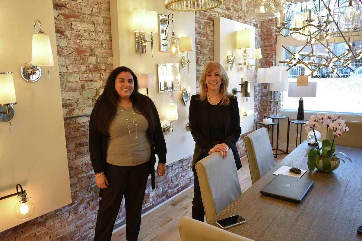 Rina Dimarte (left) and Candace Pereira, in early February 2019 at the new Chloe Winston Lighting Design boutique at 68 Water St. in South Norwalk, Conn.