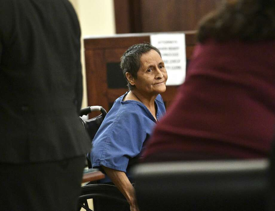 Beatrice Sampayo, 64, who is accused of helping cover up the death of her 8-month-old grandson, King Jay Davila, is wheeled through the courtroom during a bond hearing at which her bond was reduced from $250,000 to $50,000 by Judge Andrew Carruthers in Magistrate Court on Friday, Feb. 8, 2019. Photo: Billy Calzada/Staff Photographer