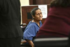 Beatrice Sampayo, 64, who is accused of helping cover up the death of her 8-month-old grandson, King Jay Davila, is wheeled through the courtroom during a bond hearing at which her bond was reduced from $250,000 to $50,000 by Judge Andrew Carruthers in Magistrate Court on Friday, Feb. 8, 2019.