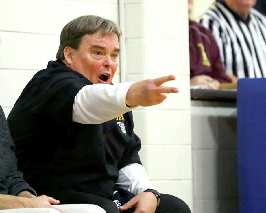 East Alton-Wood River girls basketball coach Joe Parmentier's Oilers clinched their first winning mark since 2004-2005 with a victory over rival Roxana Thursday night. Parmentier, who has retired as a teacher at EA-WR, has previously coached the Oilers boys basketball, girls basketball, football and tennis teams. Photo: Billy Hurst File | For The Telegraph