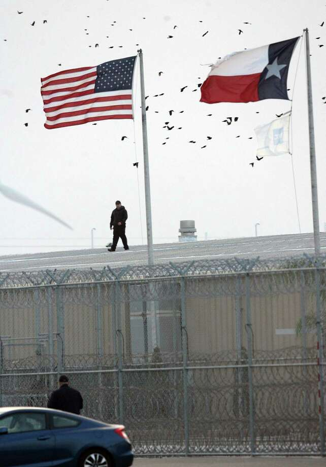 A correctional guard at the Willacy County Correctional Center in Raymondville, Texas walks on the roof of the facility where a riot broke out in 2015. Retention of guards continues to be a problem in Texas prisons. Photo: Delcia Lopez /AP / Delcia Lopez photography
