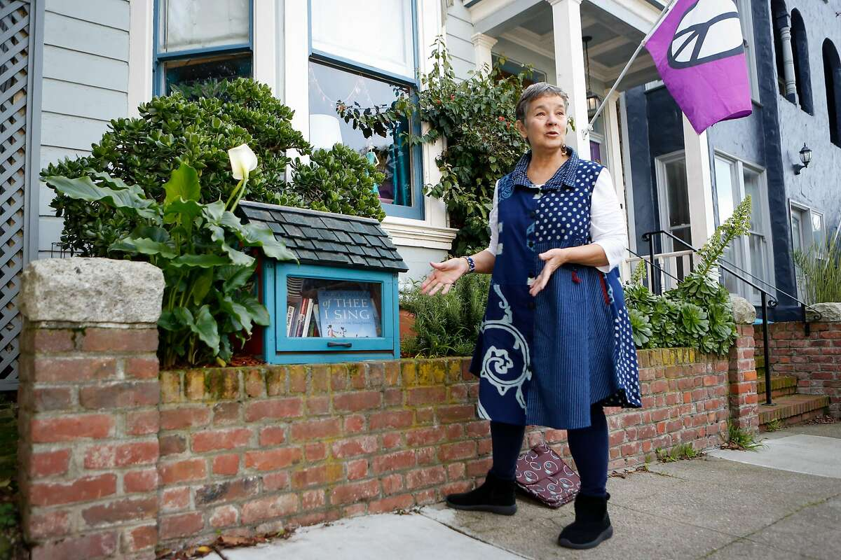 Marc Coronado talks about who uses the her small neighborhood library box on Thursday, February 7, 2019 in Bernal Heights San Francisco, Calif.