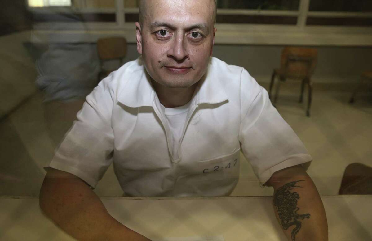 Michael Tracy talks to the Houstom Chronicle at the Texas prison system's Terrell Unit on Wednesday, Dec. 5, 2018, in Rosharon. Tracy got the dragon tattoo on his left arm after he and his friends committed a robbery, for which he was later convicted.