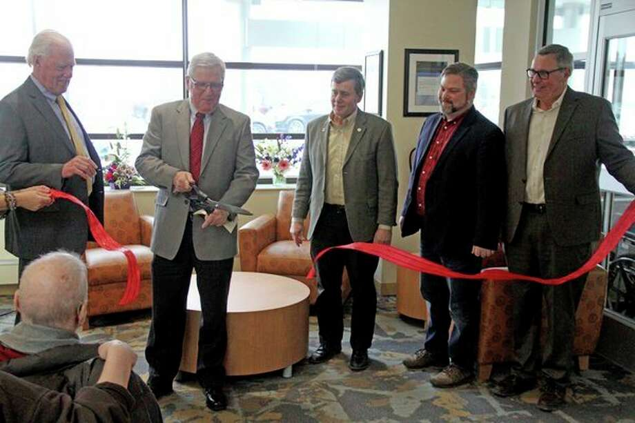 Hills & Dales General Hospital, located in Cass City, held a ribbon cutting ceremony during its open house Friday afternoon, to highlight the hospital's $6 million expansion. Pictured are, from left, Dr. Donald H. Robbins Jr., chief of medical staff; Pat Curtis, Board of Trustees president; State Sen. Kevin Daley; State Rep. Phil Green; and Herb Spence, president of Spence Brothers Construction. (Mike Gallagher/Huron Daily Tribune)