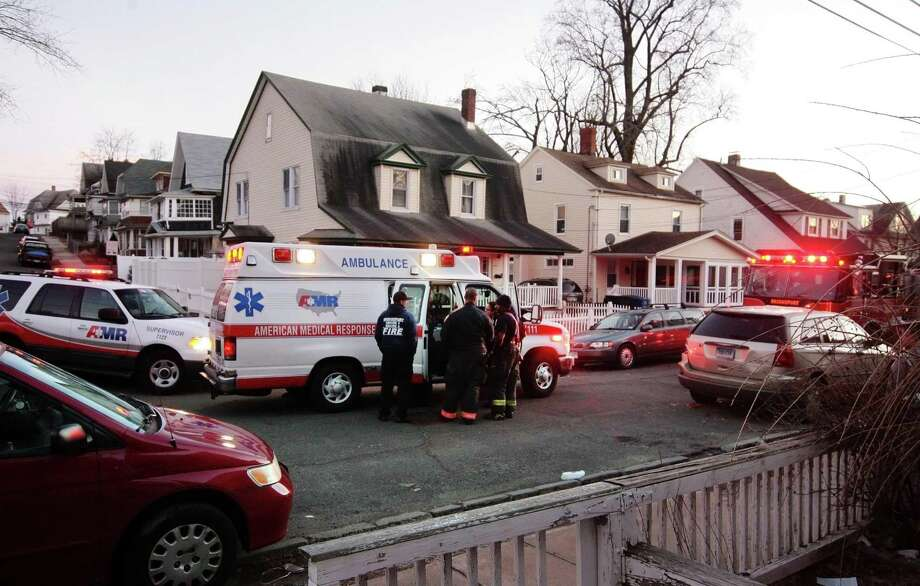 A man was struck by a vehicle in a hit-and-run on Lorraine Drive in Bridgeport, Conn., on Friday, Feb. 8, 2019. He was taken from the site of the collision by ambulance after personnel performed CPR on the victim. Photo: Christian Abraham / Hearst Connecticut Media / Connecticut Post