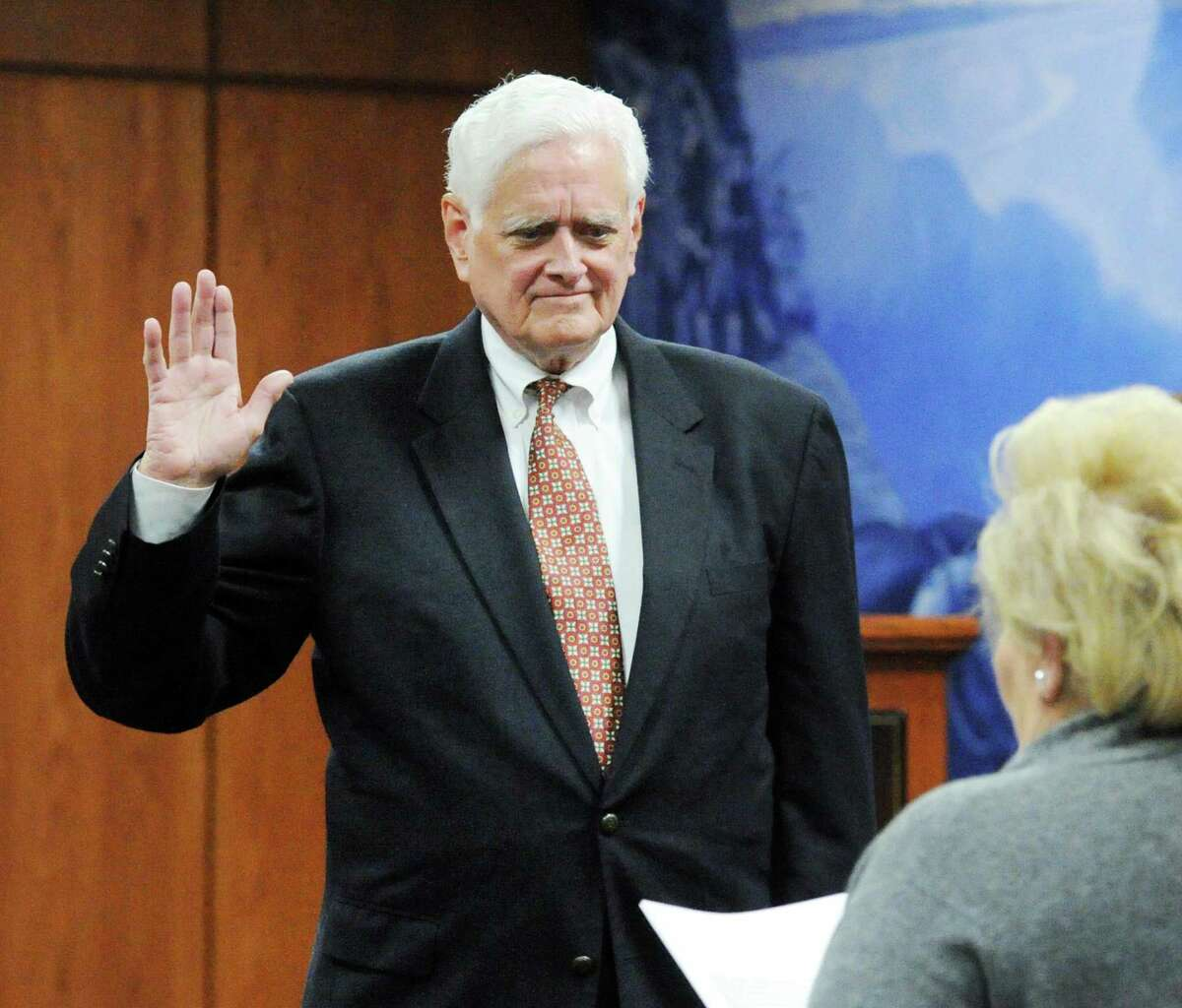 John Toner, seen here being sworn in for his second term in 2017, will not seek re-election to the town's Board of Selectmen.