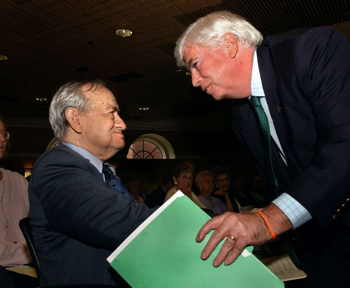 Dr. Edward Zigler is congratulated by then U.S. Sen. Chris Dodd at a special renaming ceremony at Yale University in New Haven in 2005. The Bush Center in Child Development and Social Policy was renamed the The Edward Zigler Center in his honor.