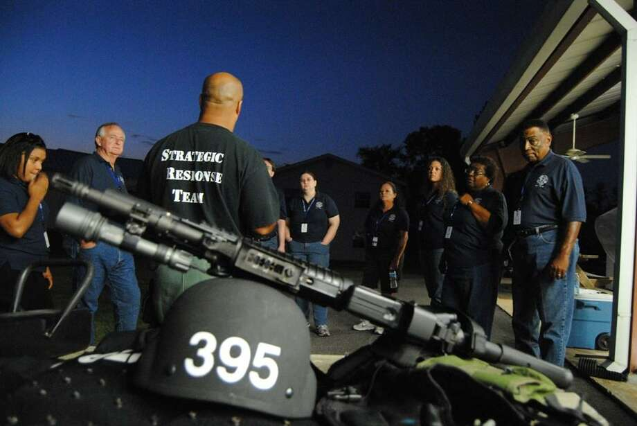 Sergeant Clifford Hatchett presents the equipment used in SRT training to the students in last year's Citizen's Police Academy at the FBI training facility in Conroe. This year's class will begin on Sept. 4. For information, contact Sergeant Rebecca Carlisle at 281-290-1312. Photo: Tomball Police Department / Internal
