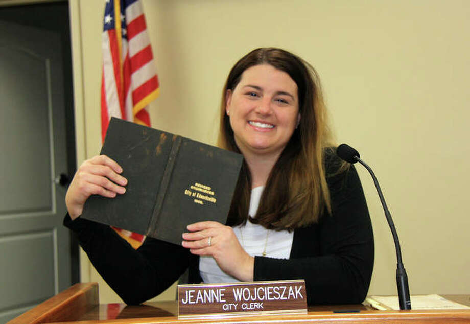 Edwardsville City Clerk Jeanne Wojcieszak holds a copy of the city's revised ordinances, circa 1905. While some things about her position may be similar to 114 years ago, there are many tasks she performs that her predecessors never would have contemplated. Photo: Charles Bolinger | The Intelligencer
