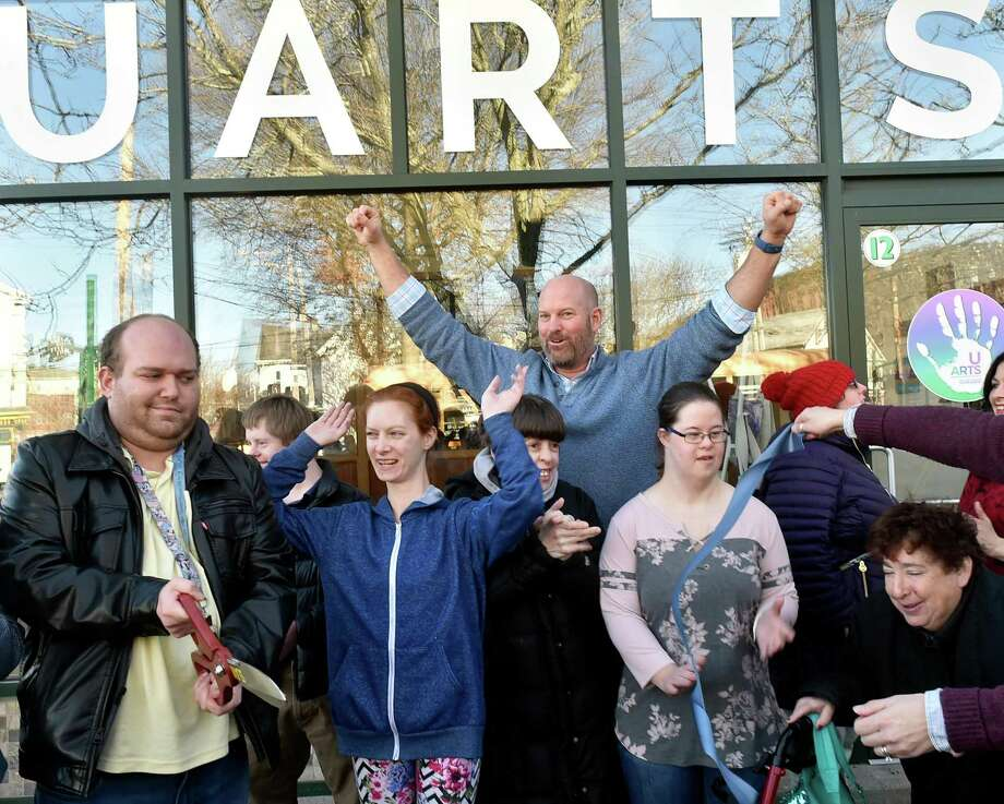 New Haven, Connecticut - Friday, February 8, 2019: Chapel Haven President Michael Storz cheers with hands upraised after the ribbon cutting as Chapel Haven celebrated a grand opening of its UARTS Chapel Haven Schleifer Center store front Friday on 12 Fountain Street in New Haven. an artisan training program, providing vocational skills for adults with developmental and social disabilities. The location is also Chapel Haven's new Center For Employment and Service Opportunities. The UARTS artisans create handmade products, using new and up cycled materials. Photo: Peter Hvizdak / Hearst Connecticut Media / New Haven Register