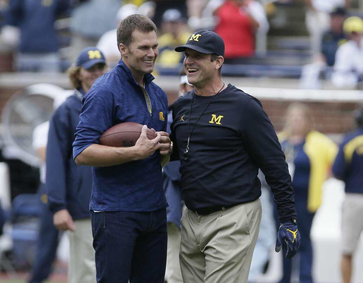 Quarterback Tom Brady of the New England Patriots laughs with head coach Jim Harbaugh of the Michigan Wolverines after they played catch before a game against the Colorado Buffaloes at Michigan Stadium on September 17, 2016 in Ann Arbor, Michigan. ]