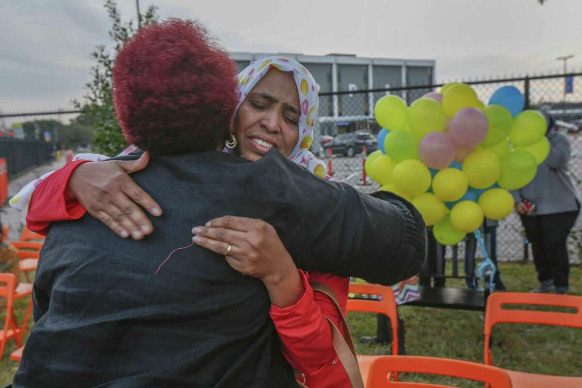 Wigdan Ahmed Mohammed, mother of Mohammed Ali Abdallah, hugs a Gulfton community member after a event honoring her son on Jan. 17. Abdallah, a young boy, was struck and killed by a motor vehicle as he walked with his parents and siblings in the intersection crosswalk on the way to school in 2016.