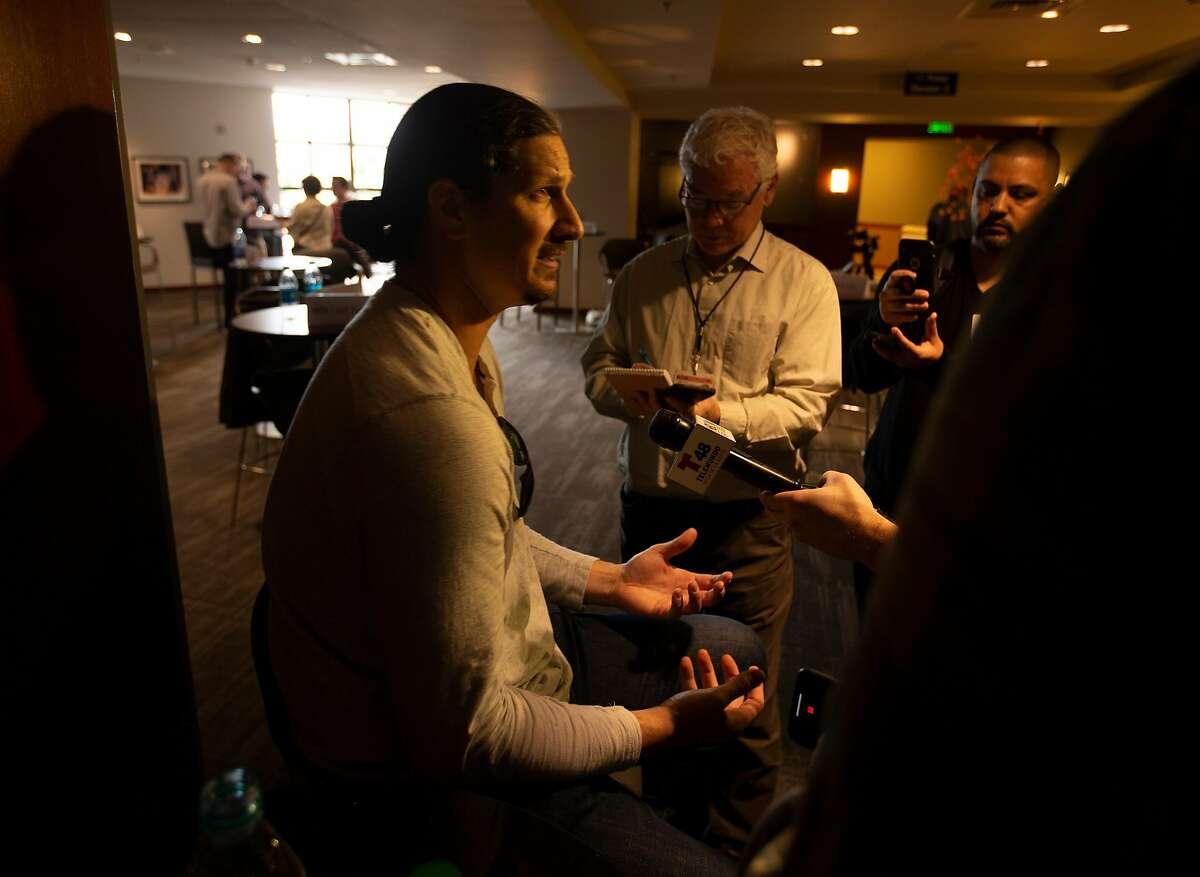 Pitcher Jeff Samardzija jokes with reporters at the San Francisco Giants media day, on Friday, Feb. 8, 2019 in San Francisco, Calif.