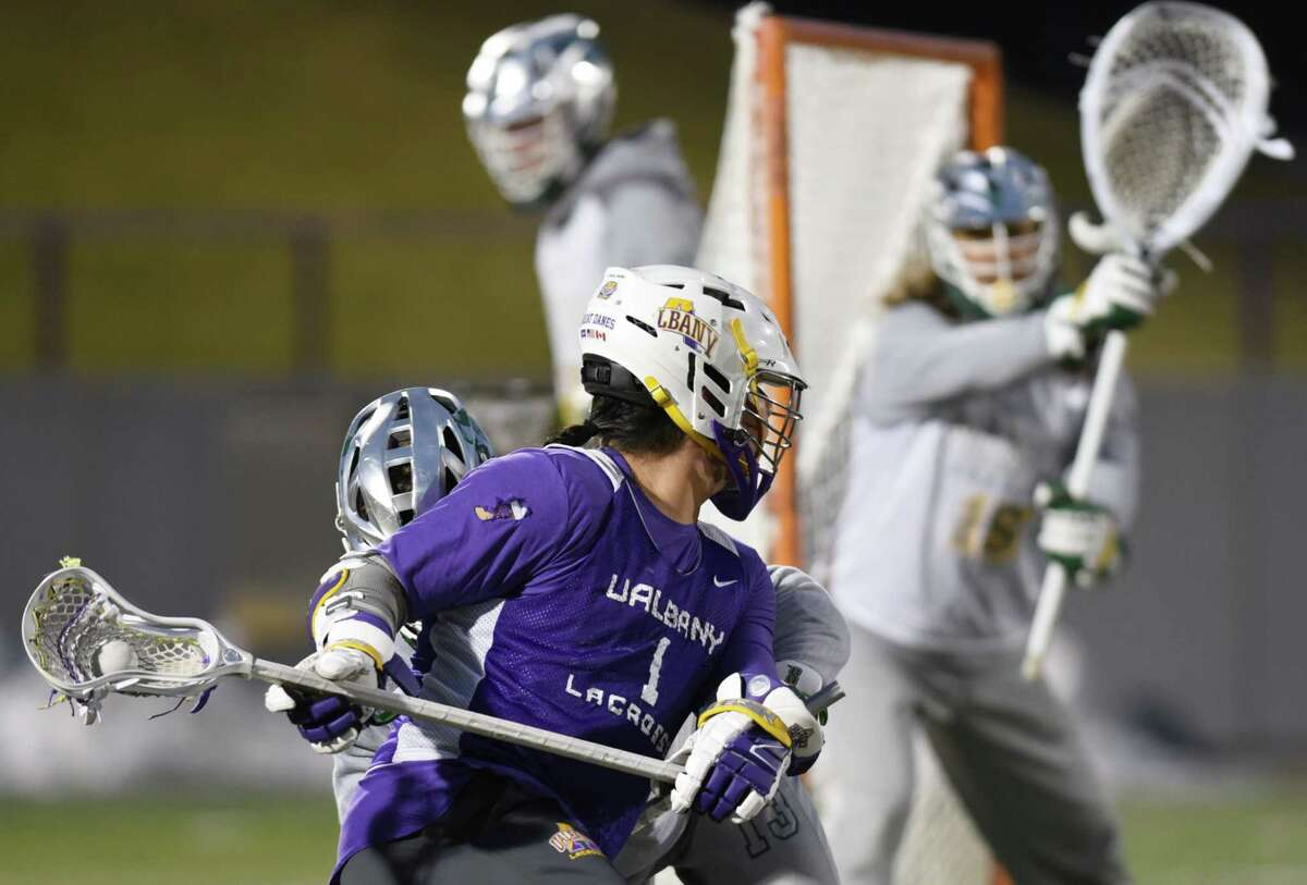 UAlbany attack Tehoka Nanticoke pivots around the goal to score during a scrimmage against Siena on Friday, Feb. 8, 2019 at UAlbany Casey Stadium in Albany, NY. (Phoebe Sheehan/Times Union)