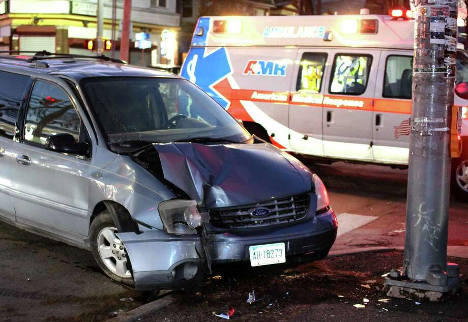 A minivan crashed into a pole off Park Avenue in Bridgeport, Conn., on Friday, Feb. 8, 2019. At least one occupant of the vehicle was taken by ambulance to a local hospital. Photo: Christian Abraham / Hearst Connecticut Media / Connecticut Post