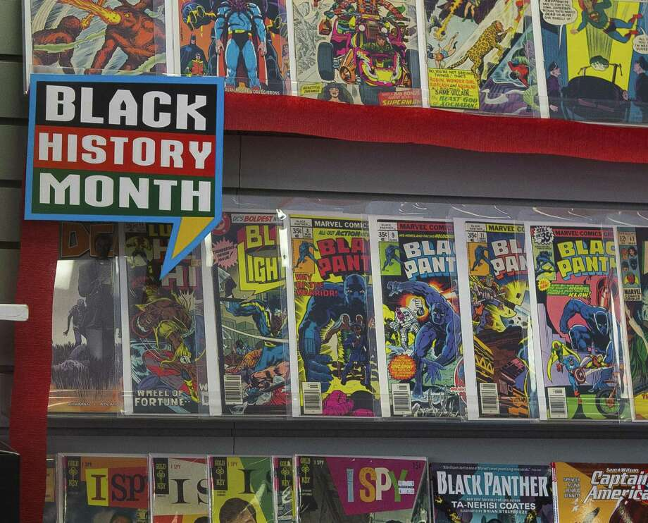 "Selected comics, including Black Panther titles, were on display in 2018 Black History Month at Bedrock City Comic Company in Houston. AMC Theaters kicked off Black History Month 2019 by offering free screenings of the ""Black Panther"" film from Feb. 1-7. The film is nominated for seven Academy Awards, including Best Picture and Best Costume Design. Photo: Mark Mulligan, Houston Chronicle / Houston Chronicle / © 2018 Houston Chronicle"
