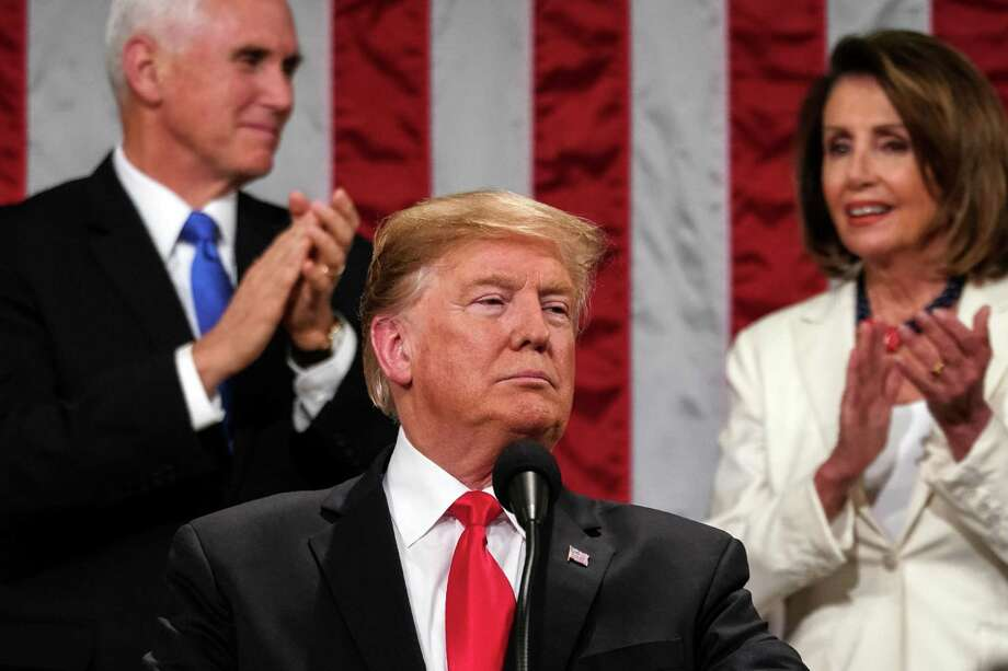 President Donald Trump is applauded by Vice President Mike Pence, left, and House Speaker Nancy Pelosi (D-Calif.) as he delivers his State of the Union address at the Capitol on Tuesday night, Feb. 5, 2019. (Doug Mills/The New York Times) Photo: DOUG MILLS, STF / NYT / NYTNS