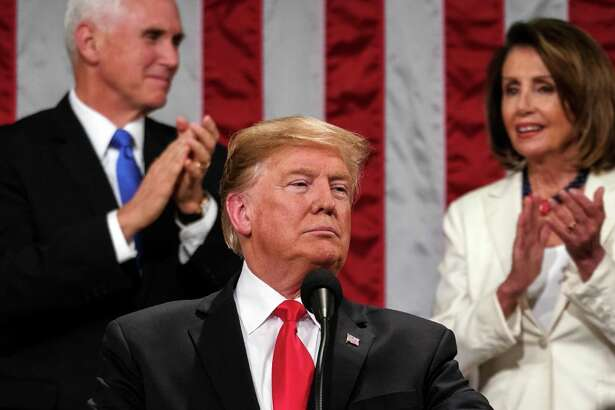 President Donald Trump is applauded by Vice President Mike Pence, left, and House Speaker Nancy Pelosi (D-Calif.) as he delivers his State of the Union address at the Capitol on Tuesday night, Feb. 5, 2019. (Doug Mills/The New York Times)