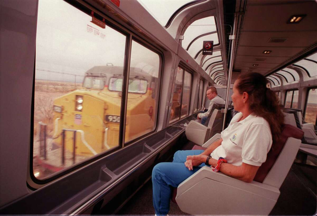 CONTACT FILED: AMTRAK (roll #4) Marilyn Cooper from San Deigo, Ca. sits in the viewing car of the Amtrak Sunset Limited on her way to California, checks out a freight train as it passes by in the West Texas country side. 02/14/2003 (E. Joe Deering/Chronicle).