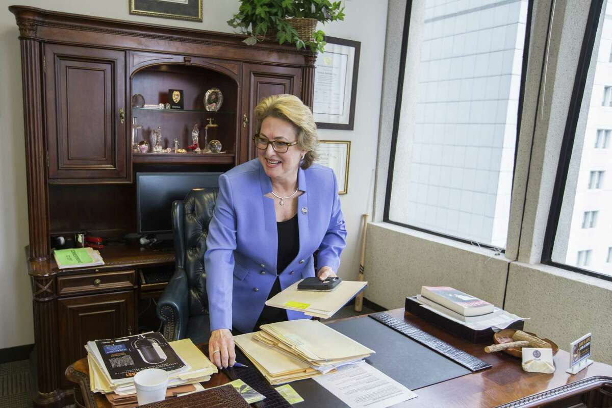 Harris County District Attorney Kim Ogg works in her office on Wednesday, Feb. 6, 2019, in Houston. Harris County District Attorney Kim Ogg is asking Commissioners Court for 100 new prosecutors to help clear a felony case backlog that was exacerbated by Hurricane Harvey. She is clashing with fellow Democrats on Commissioners Court, who appear wary of beefing up the DA's office after two ran on a platform that included criminal justice reform.
