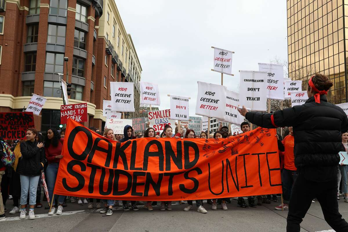 Students from Oakland Tech High School, participate in a protest on Broadway Ave. in Oakland, Calif., on Friday, February 8, 2019. Oakland Tech High School students are actively protesting to support Oakland Unified School Districts teachers who are threatening to strike if the district doesn't meet their contract demands.