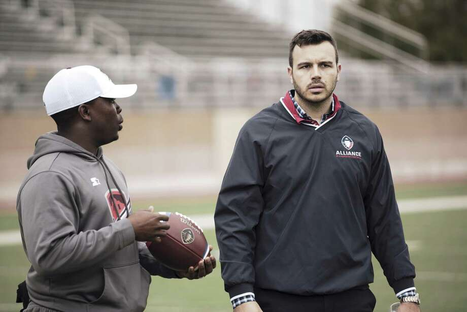 Alliance of American Football CEO Charlie Ebersol, right, walks past Commanders equipment manager Darwin Beacham. Ebersol says the new league is avoiding gimmicks and instead trying to build an audience gradually through word-of-mouth. Photo: Associated Press / Alliance of American Football