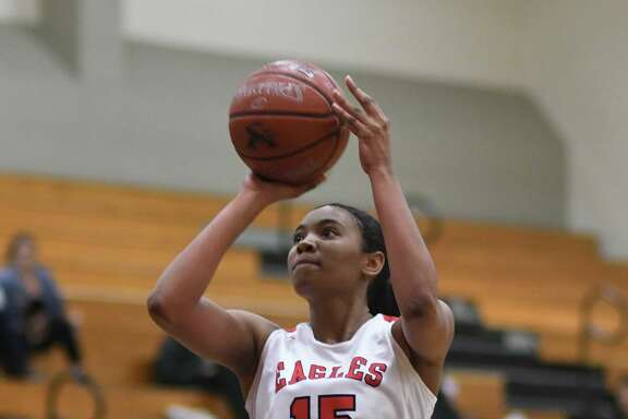 Atascocita Lady Eagle Elyssa Coleman (15) sets for a shot against Dobie during their District 22-6A matchup at Atascocita High School on Jan. 25, 2019.