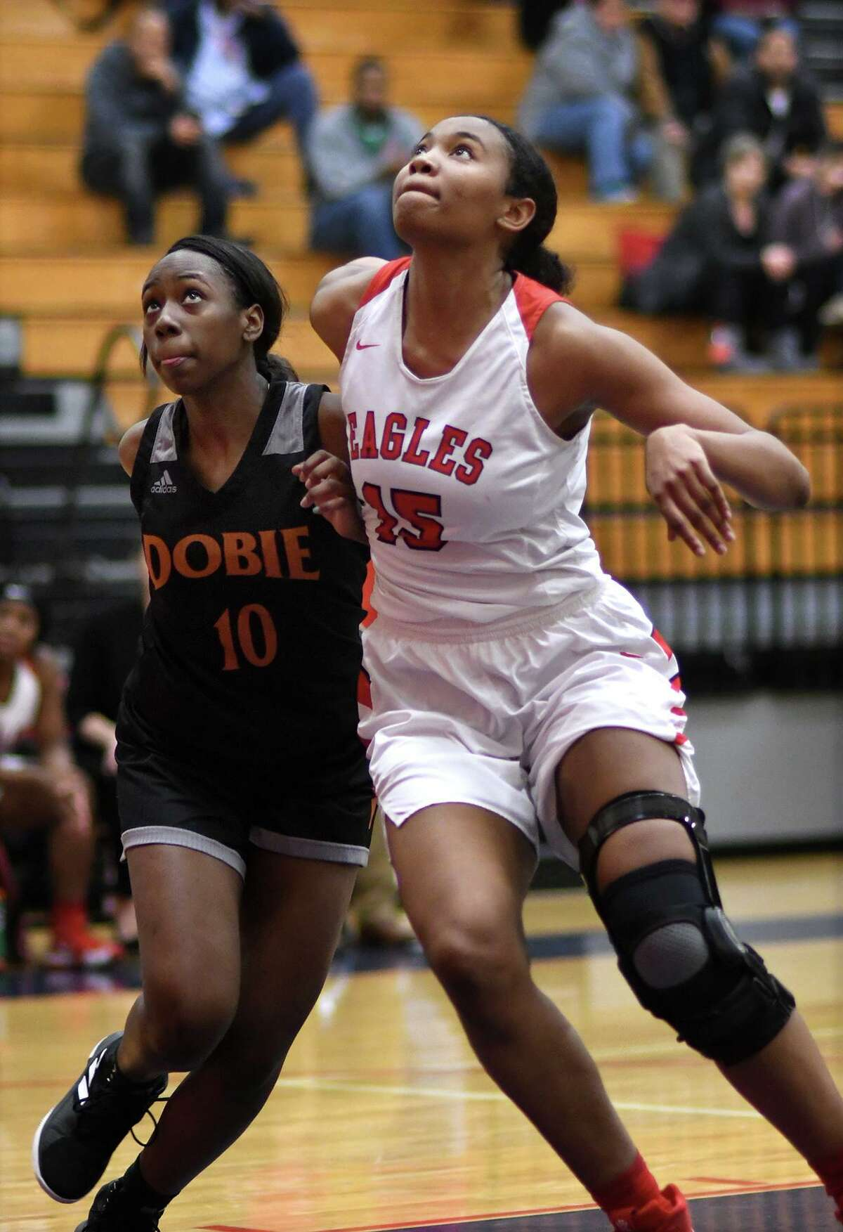 Atascocita Lady Eagle Elyssa Coleman (15) fights for rebound position against Dobie's Madison Garrett (10) during their District 22-6A matchup at Atascocita High School on Jan. 25, 2019.