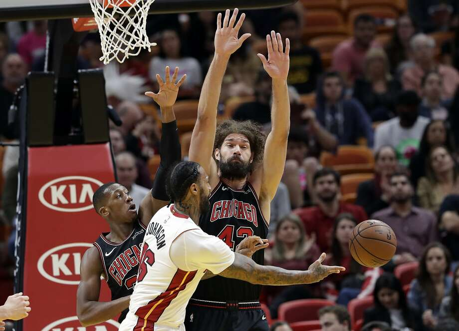 Miami Heat forward James Johnson (16) passes as Chicago Bulls guard Kris Dunn, left, and center Robin Lopez (42) defend during the first half of an NBA basketball game, Wednesday, Jan. 30, 2019, in Miami. (AP Photo/Lynne Sladky) Photo: Lynne Sladky / Associated Press